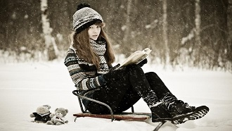 Picture of Woman on sled with book